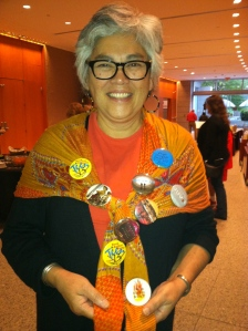 Librarian Patty Parks sporting just a few of the book buttons