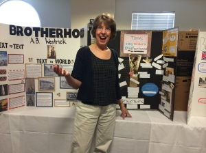 A.B.Westrick admiring a poster about her debut novel, Brotherhood