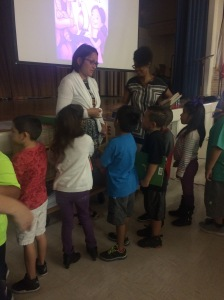 Maya and I handing out books after my talk with Reading Rockstars