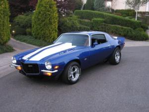 A blue 1973 Camaro - like the one Pablo drives in Burn Baby Burn. Wish I had these wheels for my travels!